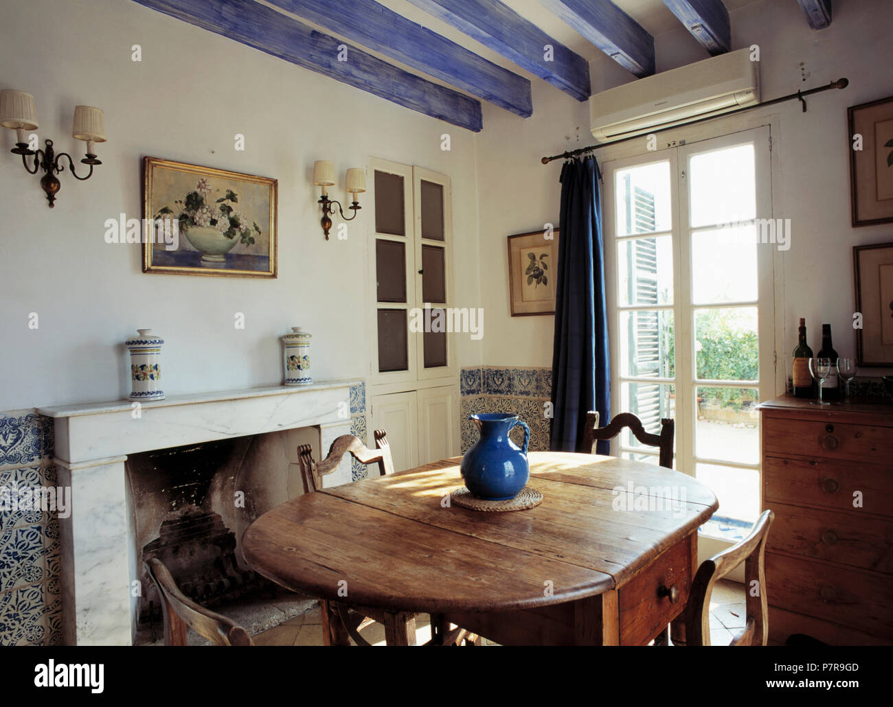 Painted Blue Ceiling Beams In Mediterranean Dining Room With ...