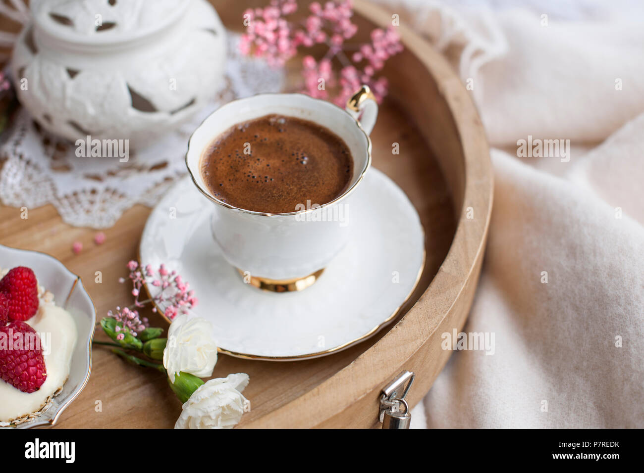 White and pink flowers. Breakfast in bed. Flavored coffee. Delicate light colors. Romance. Place for text. Stock Photo