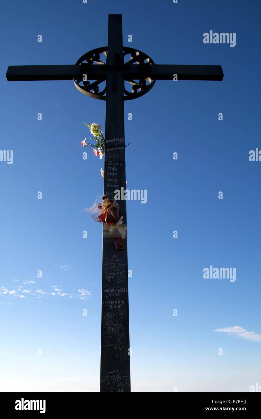 Cross Saint Miguel, Montserrat Monastery, Catalonia, near Barcelona, Spain. Close Up Detail with Sunrise Blue Sky - Stock Image