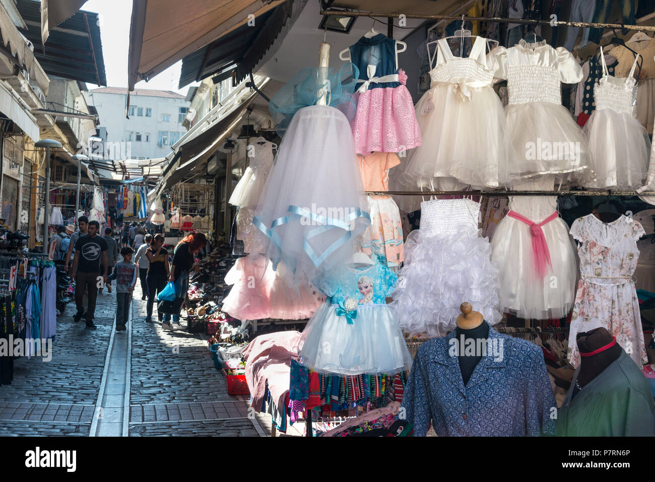 Christening dresses for sale in the Modiano Market, Thessaloniki Macedonia, Northern Greece - Stock Image