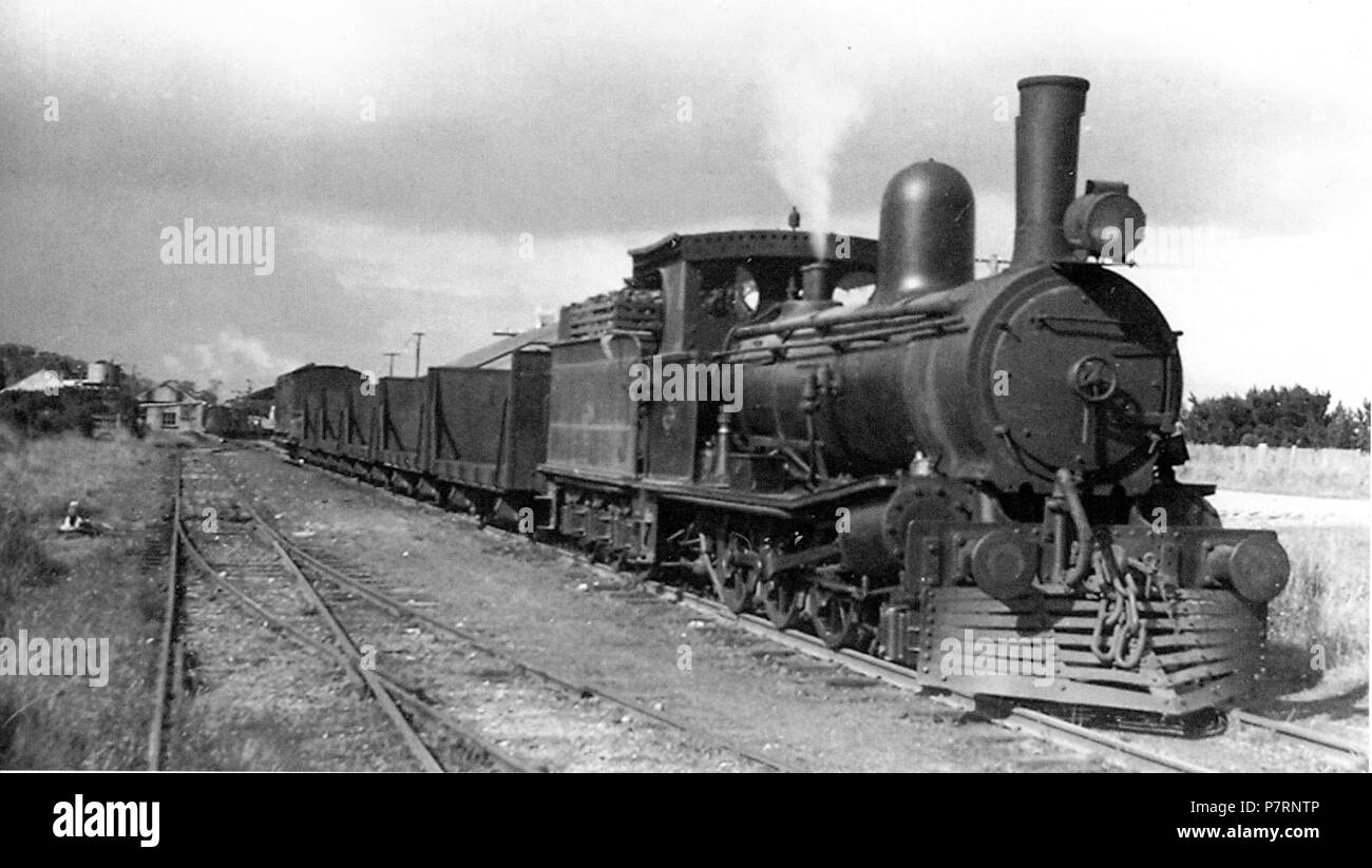 A C class loco departs Smithton with a Marrawah tramway train. I K Winney photo. This could be C28 (ex EBR #10¹) which was allocated at Smithton for a long period and used to alternate between Smithton and Zeehan. However, it appears surprising to see C28 with an extended smokebox. 1 February 1950, 00:00 349 Smithton (31556465276) - Stock Image