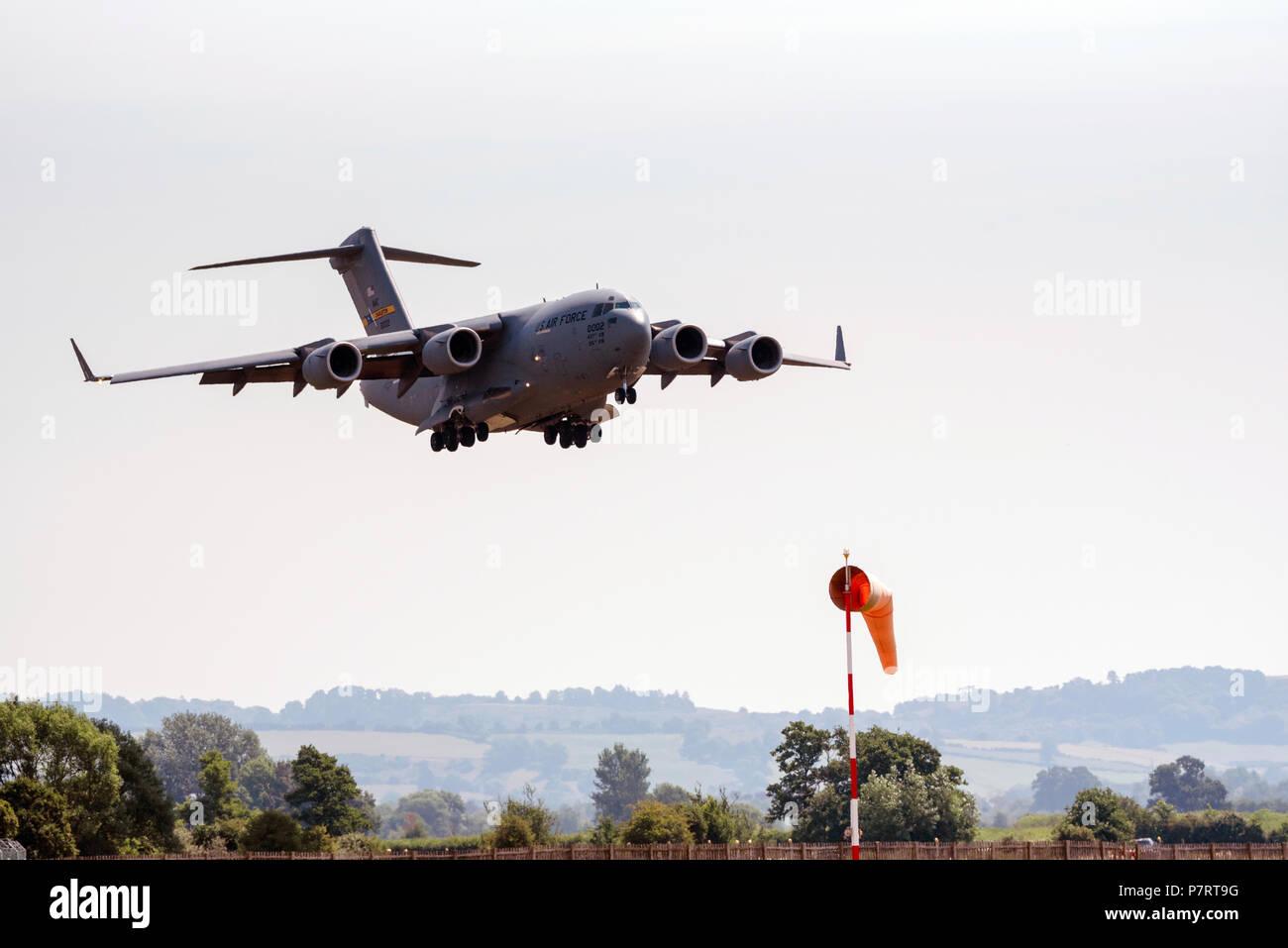 A USAF C 17 Globemaster on finals to landing at RNAS Yeovilton, Somerset, England, UK - Stock Image