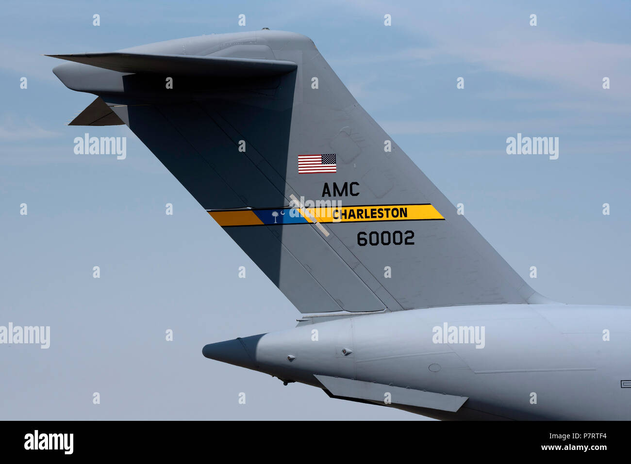 A USAF C 17 Globemaster  showing Charleston 60002 painted on the tail - Stock Image