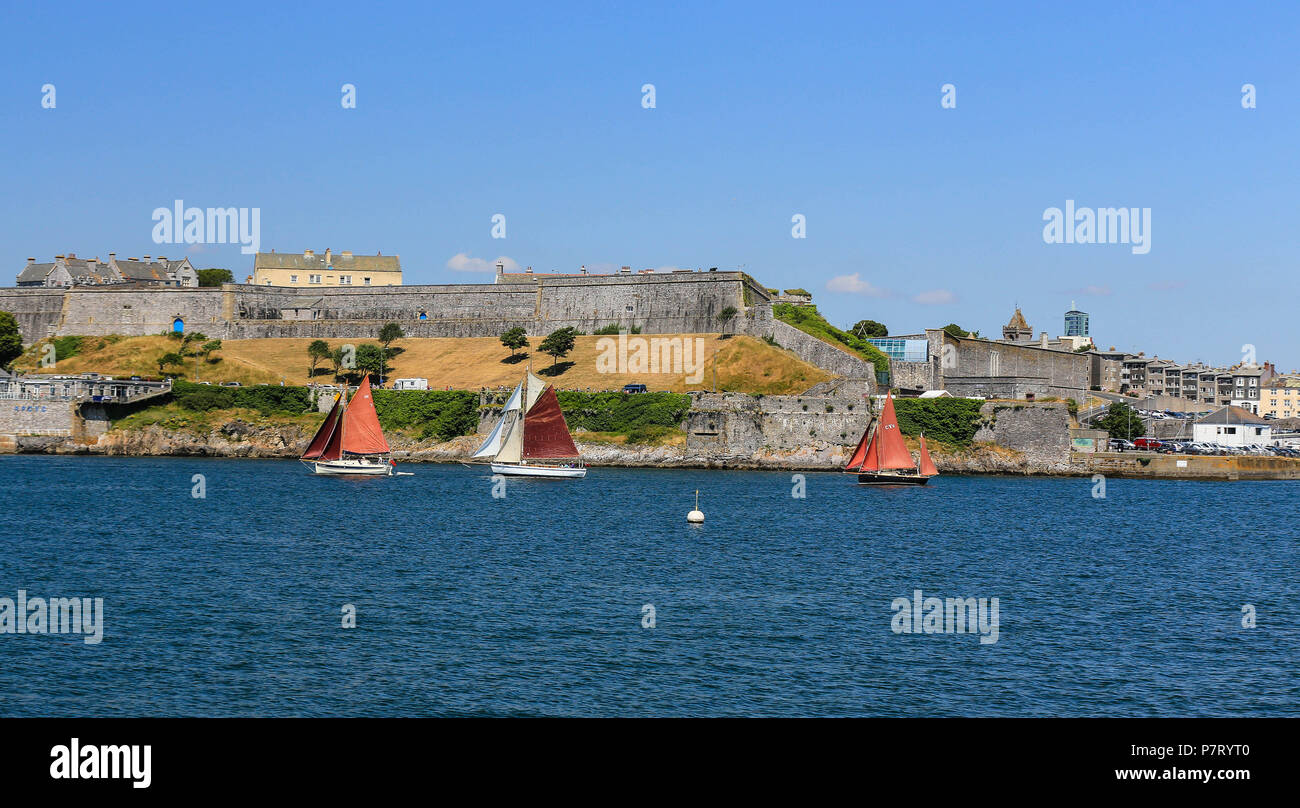 Classic Yachts sailing past Smeaton's Tower,Plymouth Hoe ,England,uk - Stock Image