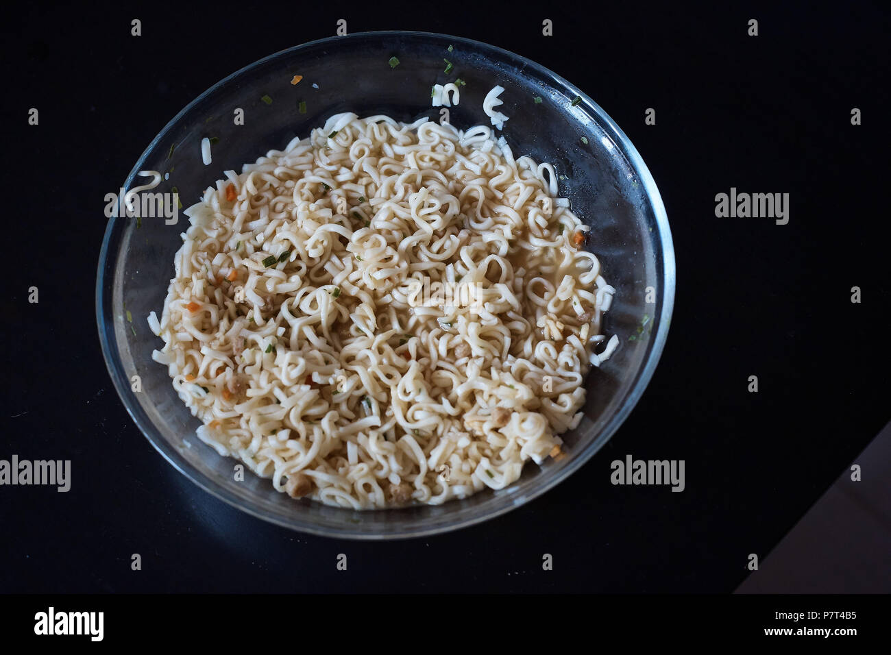Instant noodles on wood baord - Stock Image