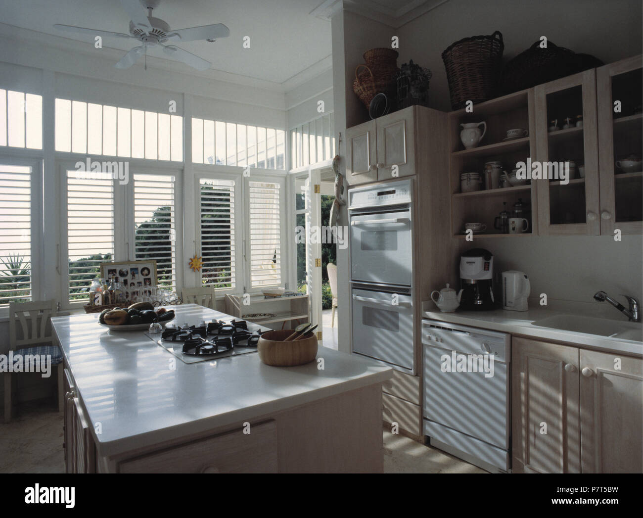 Hob In Island Unit In Caribbean Kitchen With White Slatted