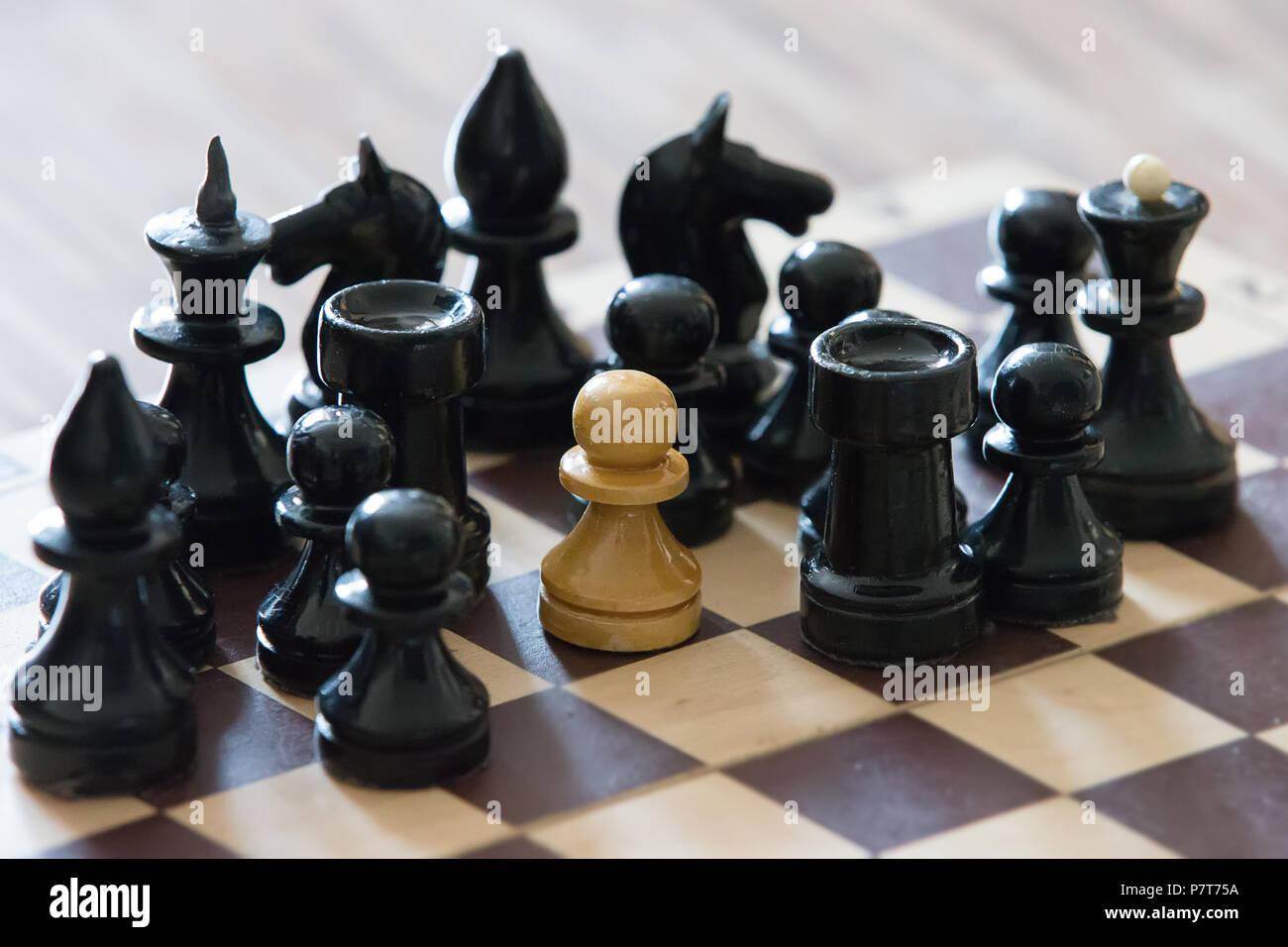 Chessmen. Concept white and black - Stock Image