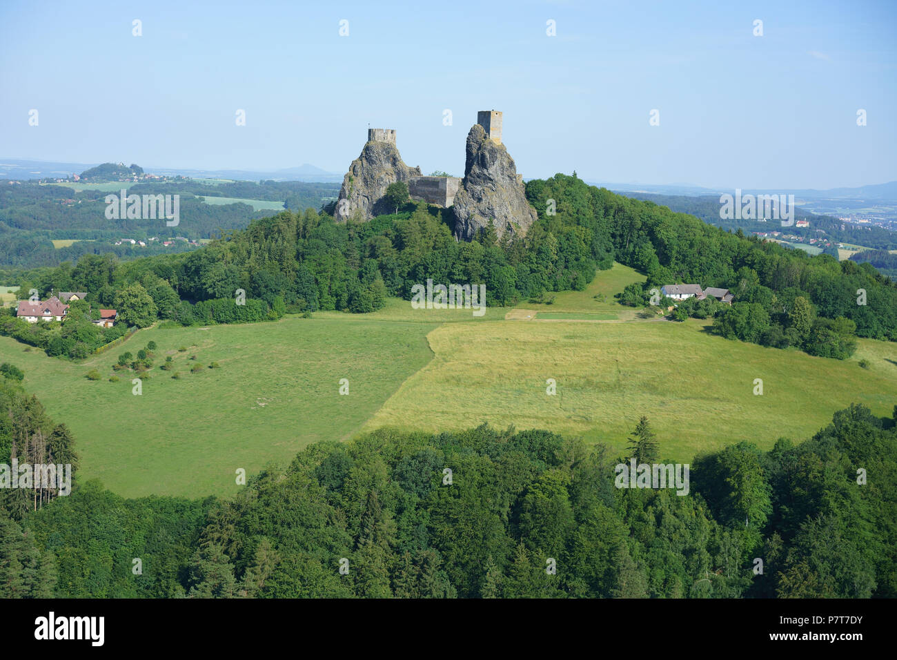 MEDIEVAL CASTLE PERCHED HIGH ON A NARROW BASALTIC TWIN PEAK (aerial view). Trosky Castle, Troskovice, Bohemia, Czech Republic. - Stock Image