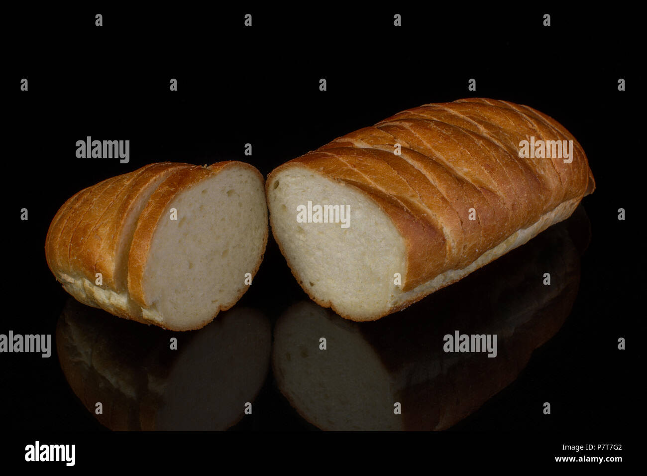 Ordinary white loaf on a black background Stock Photo