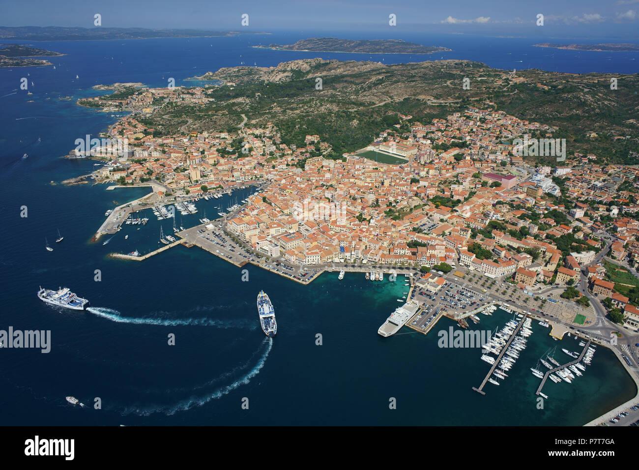 CITY OF LA MADDALENA WITH NON-STOP CAR FERRIES LINKING TO THE MAIN ISLAND OF SARDINIA (aerial view). Province of Olbia-Tempio, Sardinia, Italy. Stock Photo
