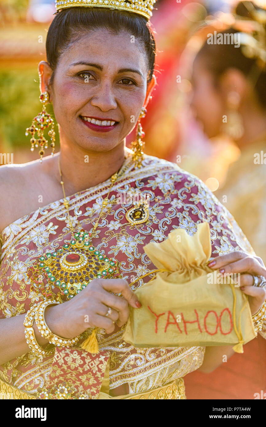 Calgary Stampede Parade 2018. Woman from the Thai Community holding a 'Yahoo' sign at the parade - Stock Image