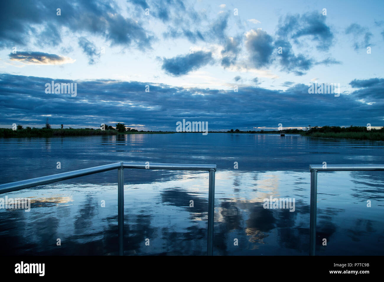 The blue evening light on the Kavango river between Namibia and Angola. - Stock Image