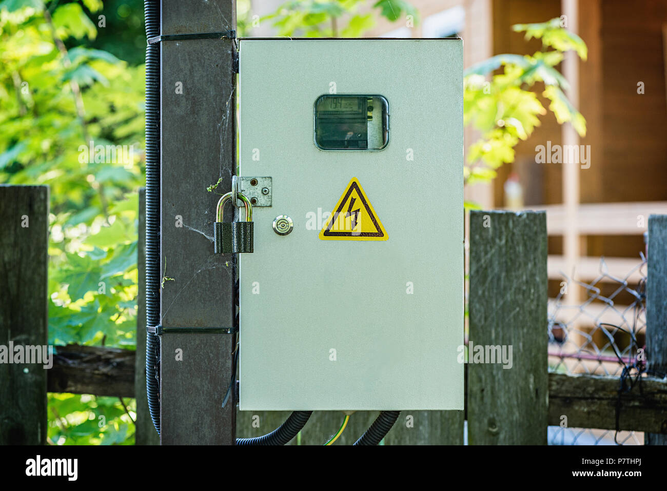 A electric power meter measuring power usage in the box. - Stock Image