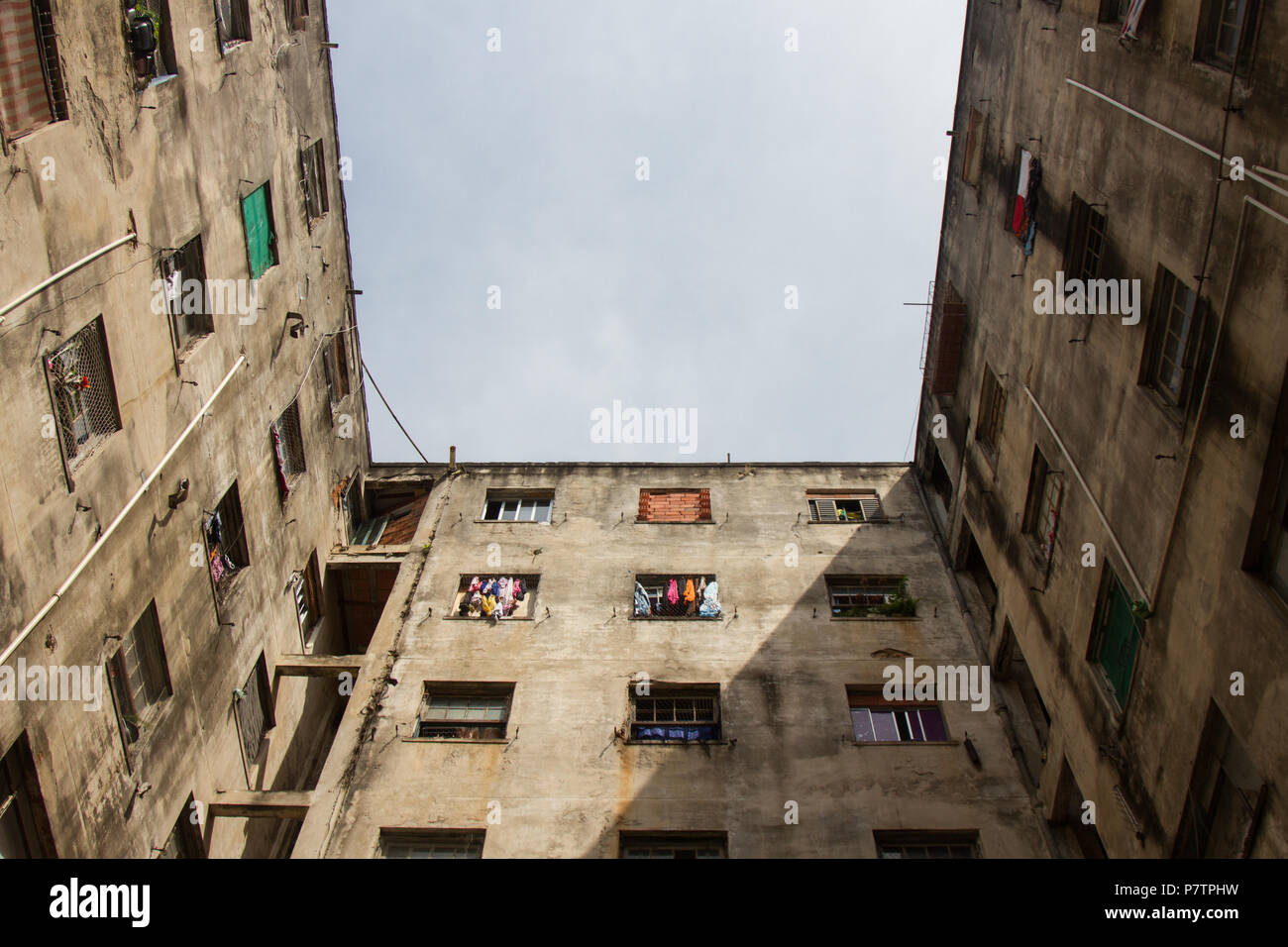 Worn building used as home by poor people Stock Photo - Alamy