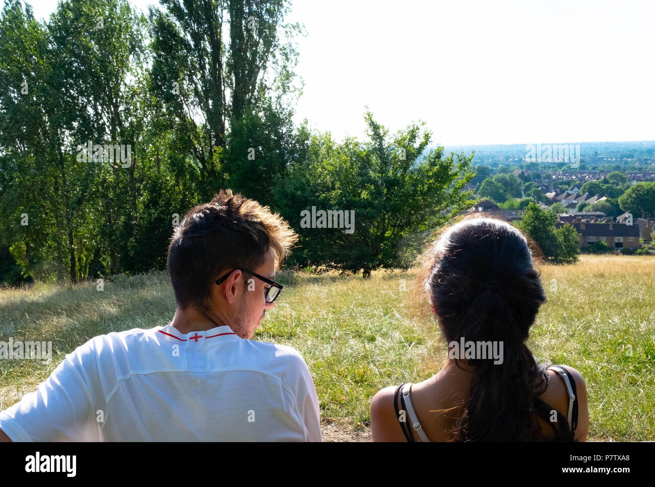 London, England. 7th July 2018. Ekta and Dan enjoying the view over Harrow in the sunshine. The present heatwave is set to continue. ©Tim Ring/Alamy Live News Stock Photo