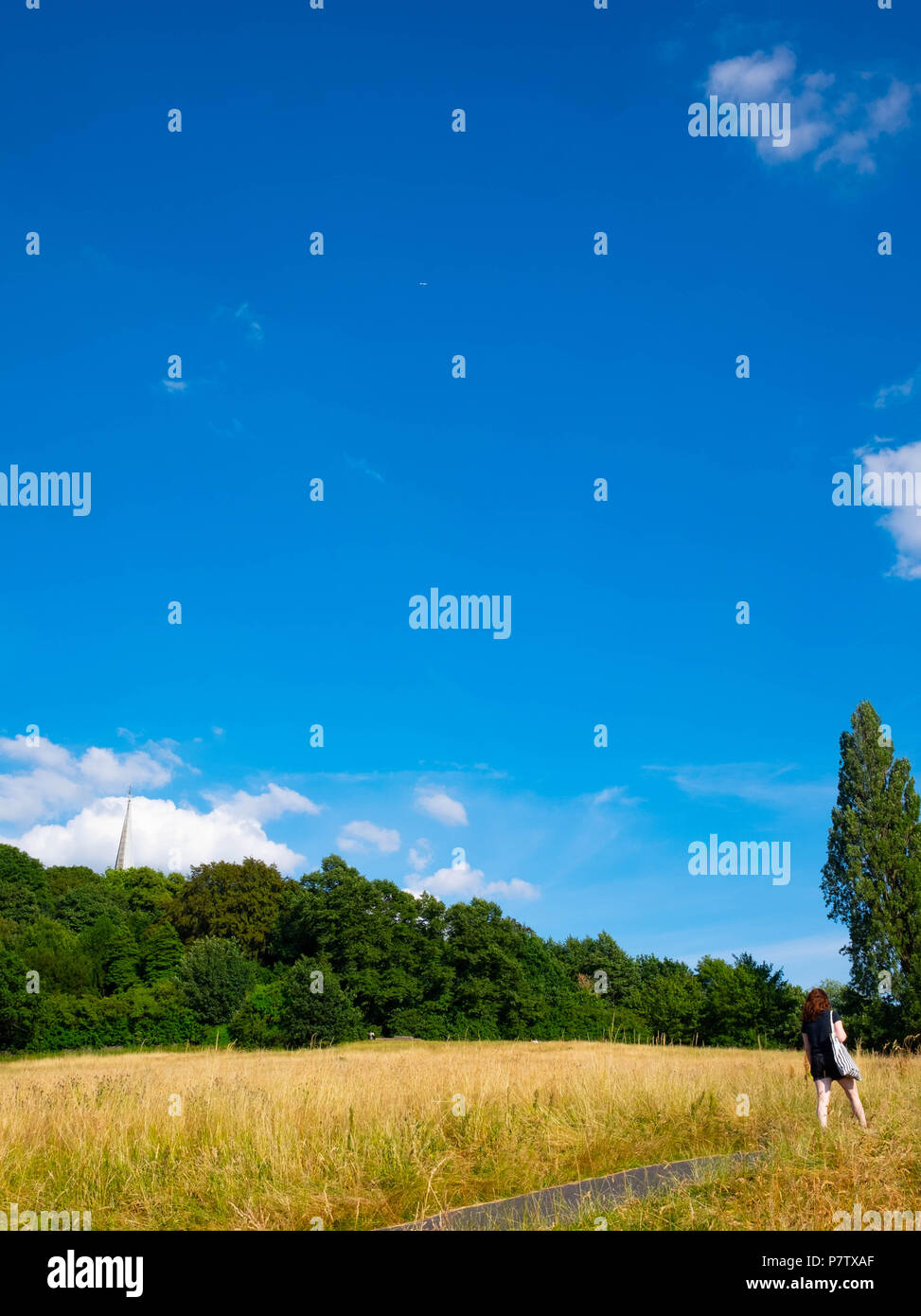 London, England. 7th July 2018. A young woman enjoying a walk on Harrow-on-the Hill in the afternoon sunshine. The present heatwave is set to continue. ©Tim Ring/Alamy Live News Stock Photo