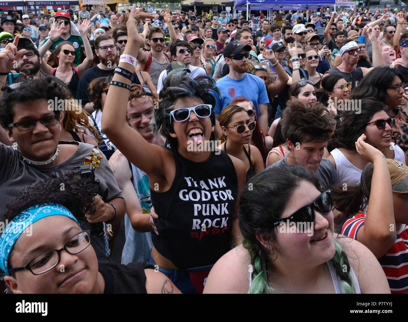 San Antonio, USA. 7th July 2018. Fans cheer during the Vans Warped Tour June 7, 2018 in San Antonio, Texas. Credit: Robin Jerstad/Alamy Live News - Stock Image