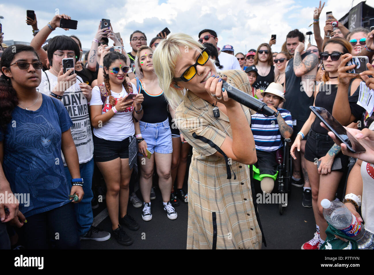 San Antonio, USA. 7th July 2018. JENNA MCDOUGALL of Tonight Alive sings while walking through the crowd during the Vans Warped Tour June 7, 2018 in San Antonio, Texas. Credit: Robin Jerstad/Alamy Live News - Stock Image