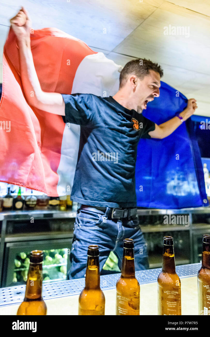 Celebrating - Brighton, UK. 8 July 2018. Brighton based French bar manager Francois Monin breaks the World Record for beer bottle opening at myhotel Brighton, resoundingly beating the previous record of 97 bottles with a total of 107 bottles opened in under a minute. Brighton, East Sussex, UK. photo ©Julia Claxton - Stock Image