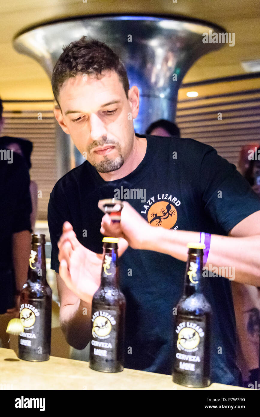 Brighton, UK. 8 July 2018. Brighton based French bar manager Francois Monin breaking the World Record for beer bottle opening at myhotel Brighton, resoundingly beating the previous record of 97 bottles with a total of 107 bottles opened in under a minute. Brighton, East Sussex, UK. photo ©Julia Claxton - Stock Image