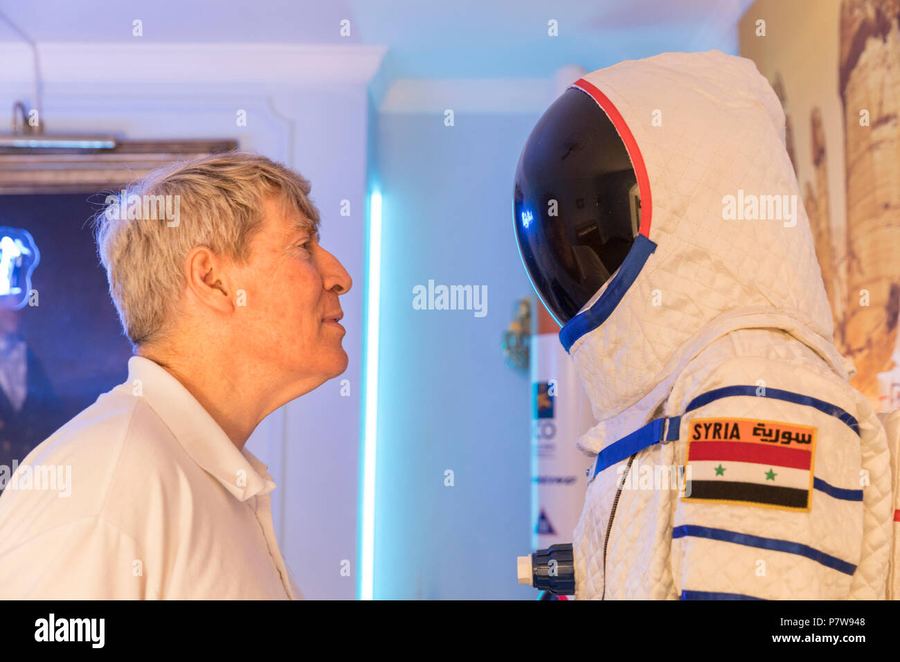 London, 8th July 2018.The British Interplanetary Society's Alistair Scott looks at the Syrian cosmonaut in the installation 'Space Refugee' about first Syrian cosmonaut Muhammed Faris. Art Night 2018 features 12 special projects curated by Hayward Gallery and over 50 presented in Art Night Open curated by cultural organisations and creatives throughout South Bank, Vauxhall and Nine Elms, on Saturday 7th and Sunday 8th July. Credit: Imageplotter News and Sports/Alamy Live News - Stock Image