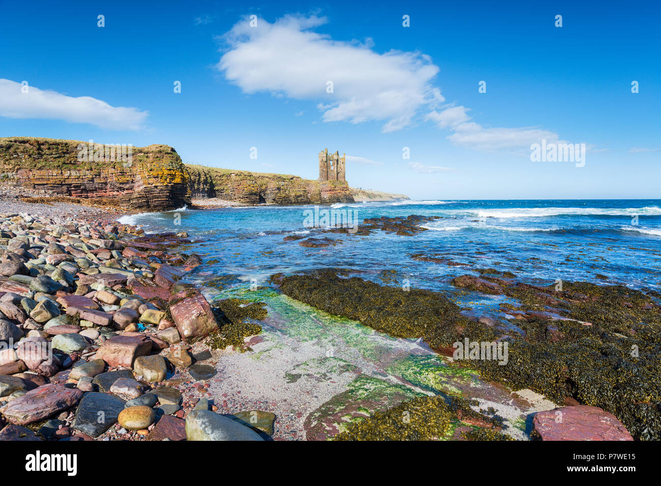 The ruins of Keiss castle perched on a cliff in the far north east of Scotland - Stock Image