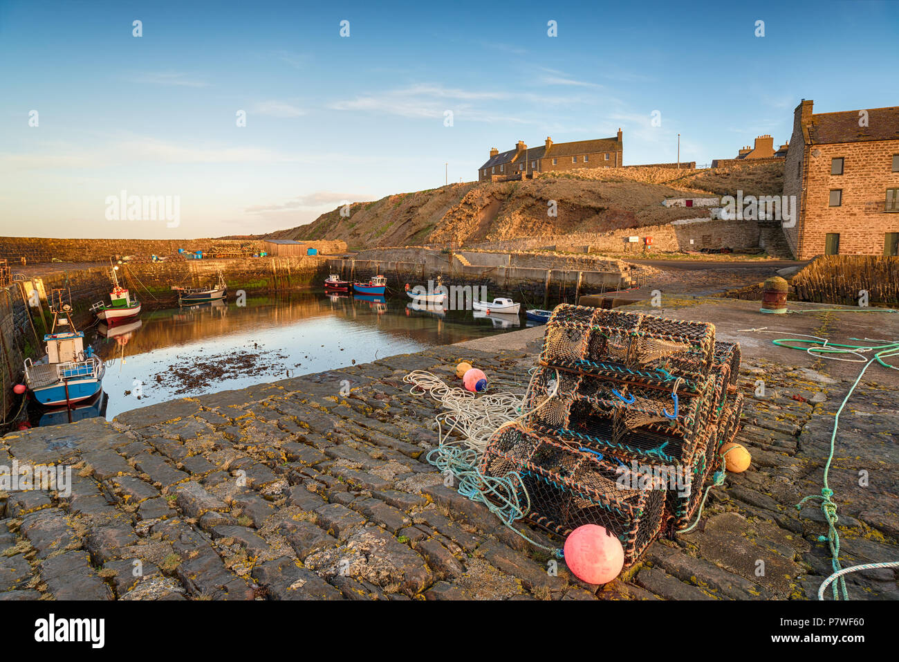 Fishing boats in the harbour at Keiss in Caithness on the not east coast of Scotland - Stock Image