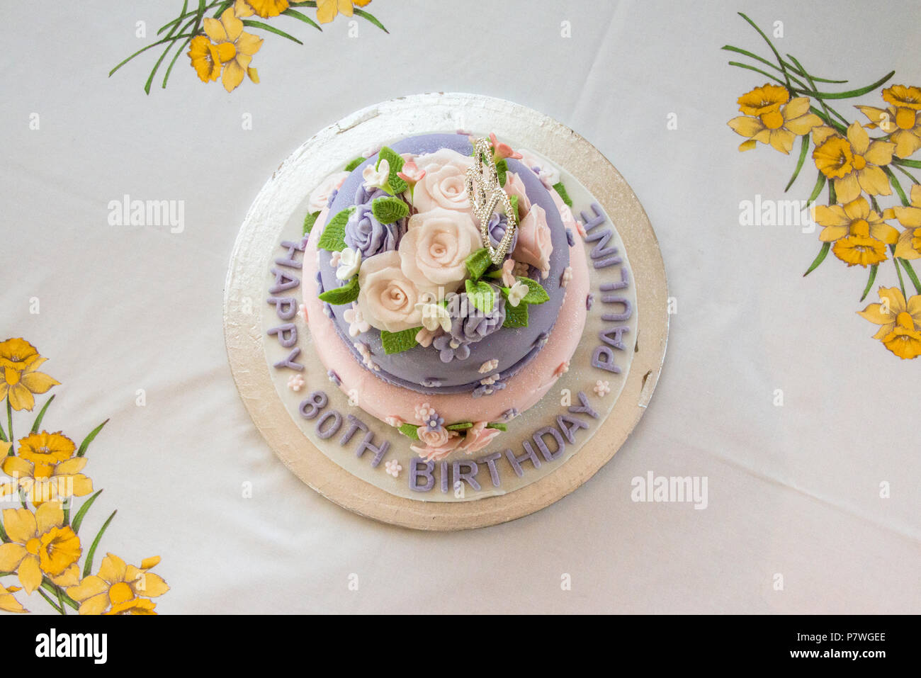 Two tier decorated 80th birthday cake - Stock Image
