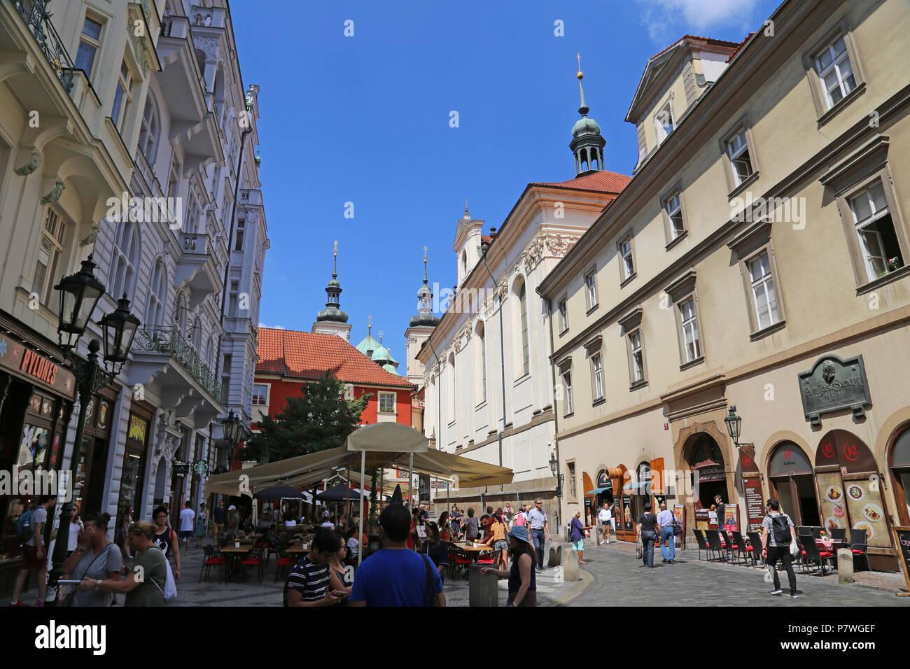 Street cafes and Clementinum entrance, Karlova, Staré Město (Old Town), Prague, Czechia (Czech Republic), Europe - Stock Image