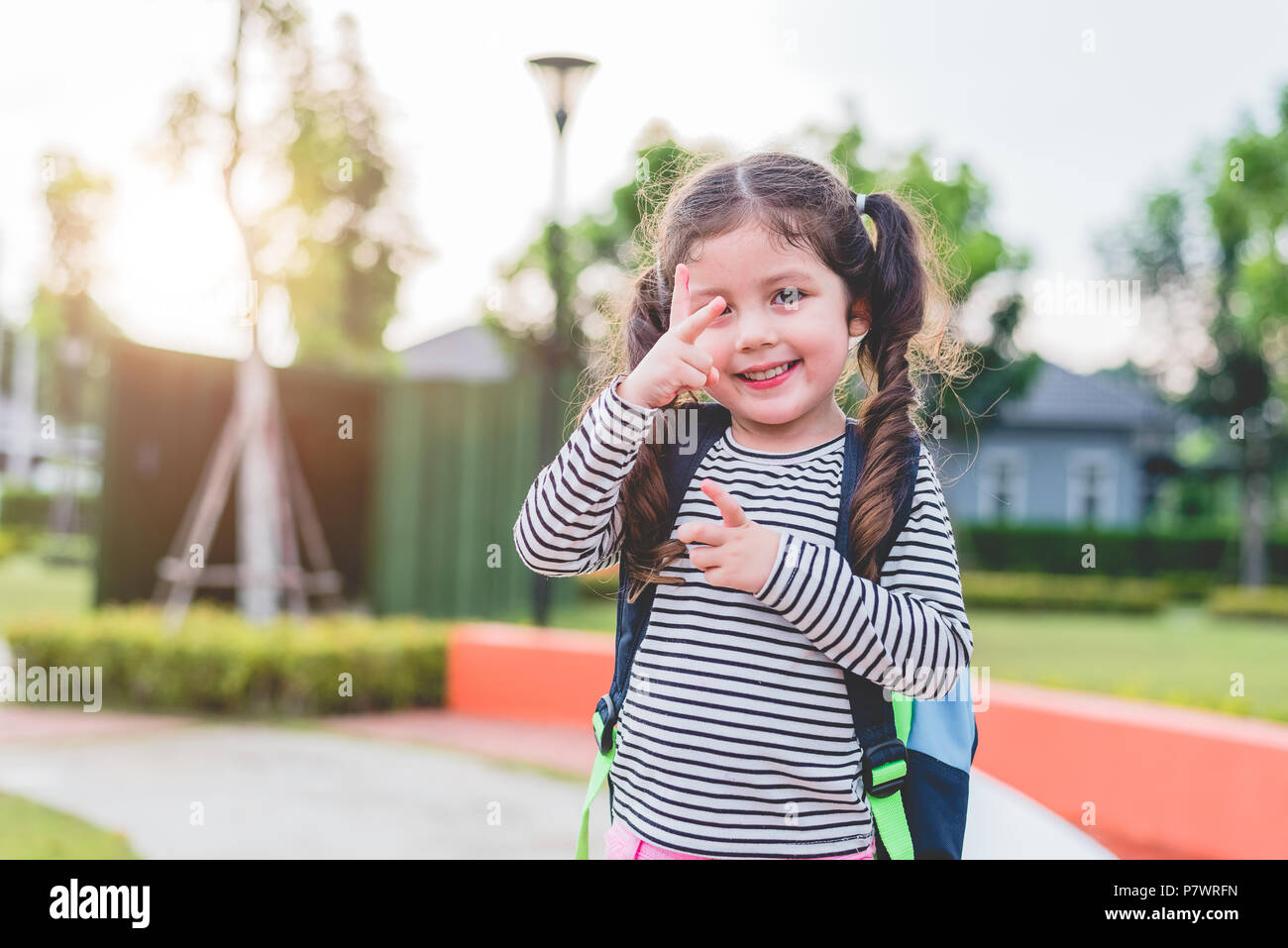 0947d580293e9 Happy little girl enjoy going to school. Back to school and Education  concept. Happy life and family lifestyle theme.