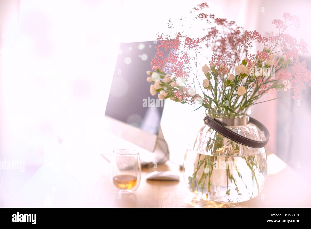 Bouquet of flowers desk stock photos bouquet of flowers desk stock a bouquet of flowers in a round vase on a table by the window a izmirmasajfo