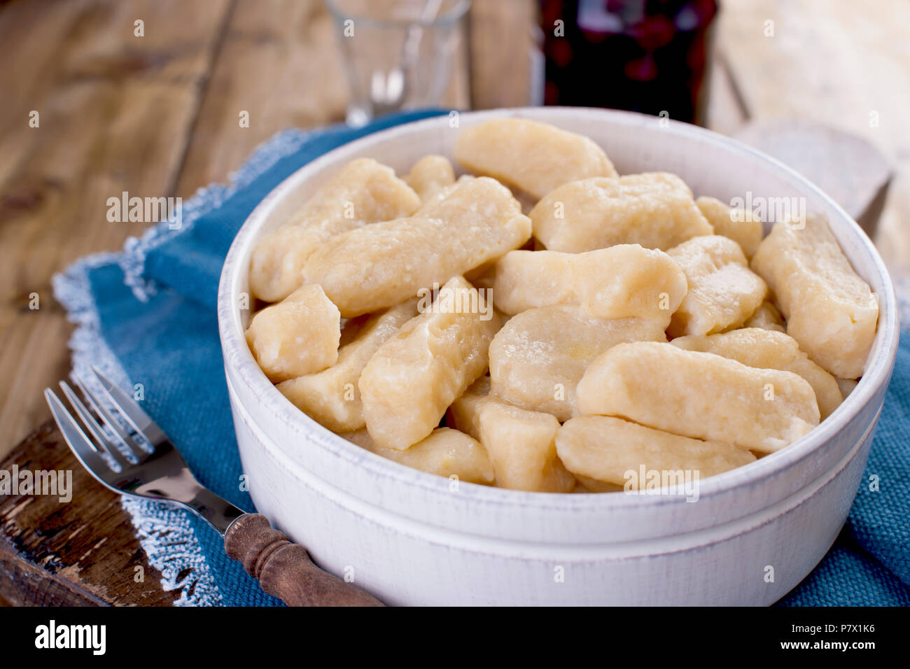 Homemade dumplings with cheese and vanilla. In a rustic style, in a ceramic cup. Healthy vegetarian food. Home cooking. Russian kitchen. Stock Photo