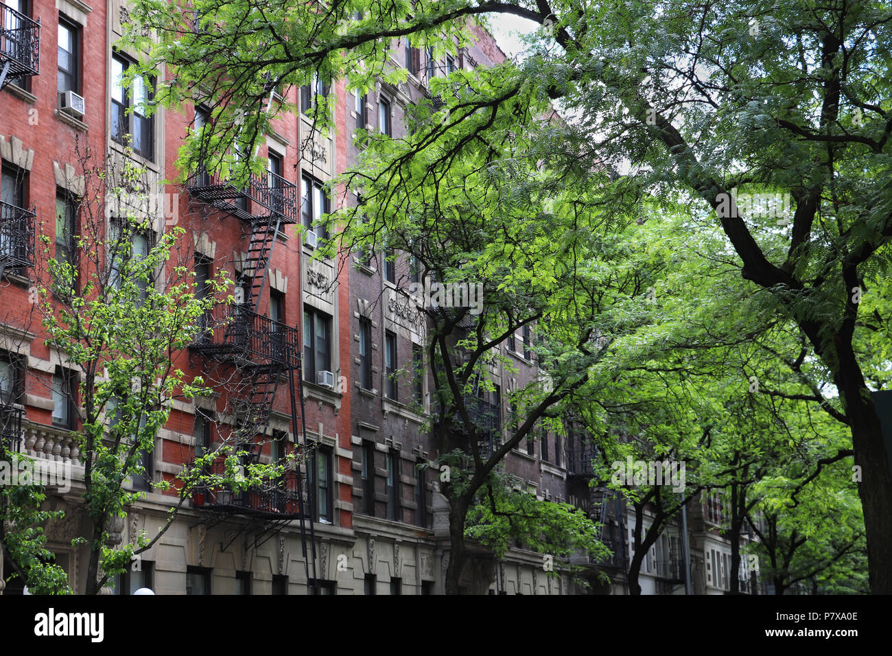 The elegant pre-war red brick apartment buildings on quiet W. 111th Street on the Upper Westside of New York City, near Columbia University. Stock Photo