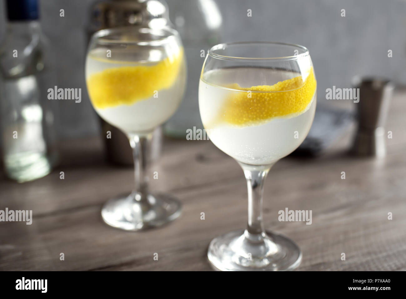 Vesper Martini Cocktail with lemon wedge. Homemade Vesper Cocktail on table, copy space. Stock Photo