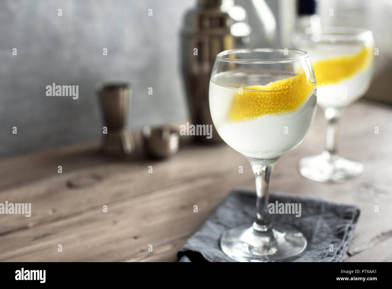Vesper Martini Cocktail with lemon wedge. Homemade Vesper Cocktail on table, copy space. Stock Photo