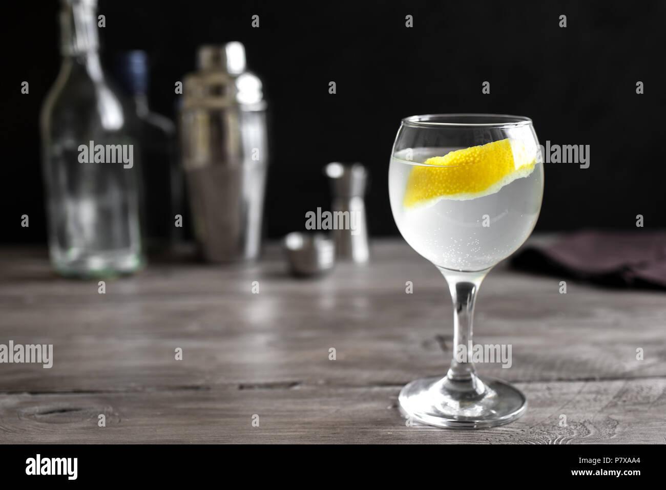 Vesper Martini Cocktail with lemon wedge. Homemade Vesper Cocktail on table, copy space. - Stock Image