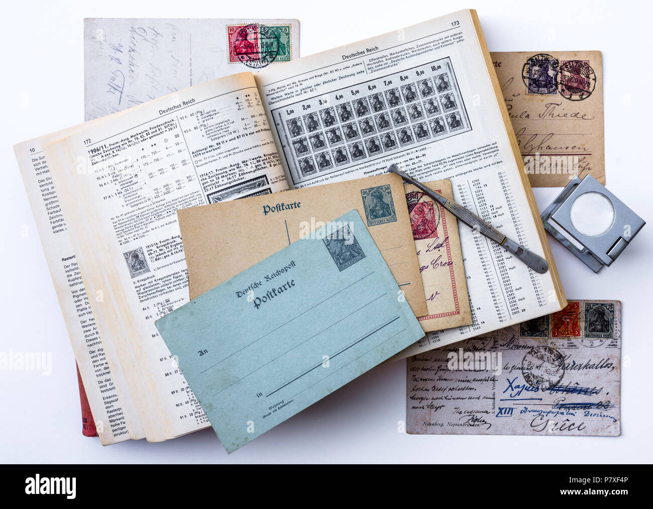 German 1920S Germania stamps on postcards and Michel specialised catalogue handbook. - Stock Image