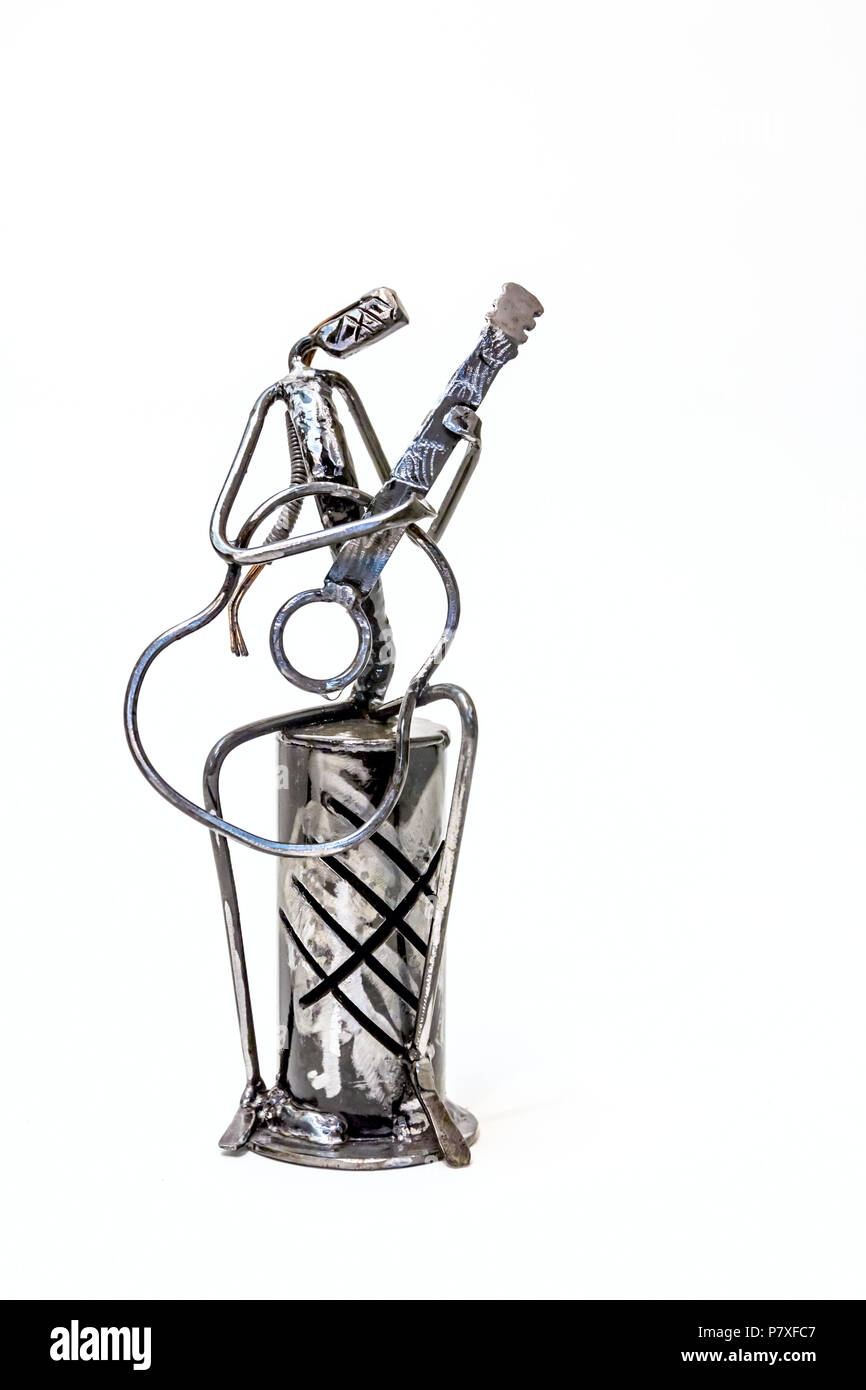 Figure of music performer made with welded black metal wire, guitarist playing solo, living lines. - Stock Image