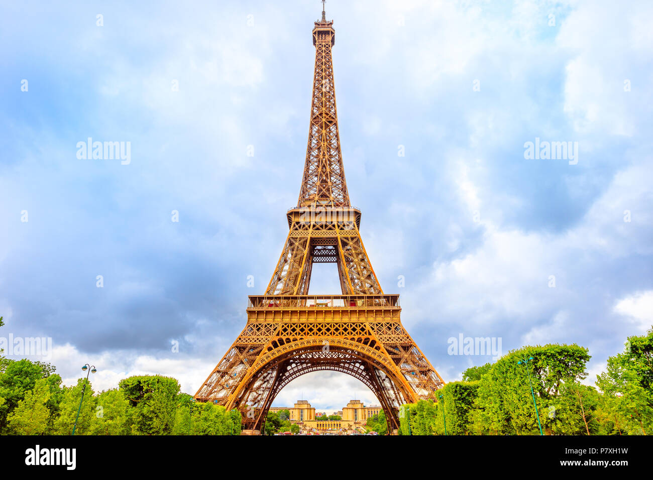 Tour Eiffel, symbol and icon of Paris from Champ de Mars garden in Paris, France. Europe travel concept. Cloudy day. - Stock Image