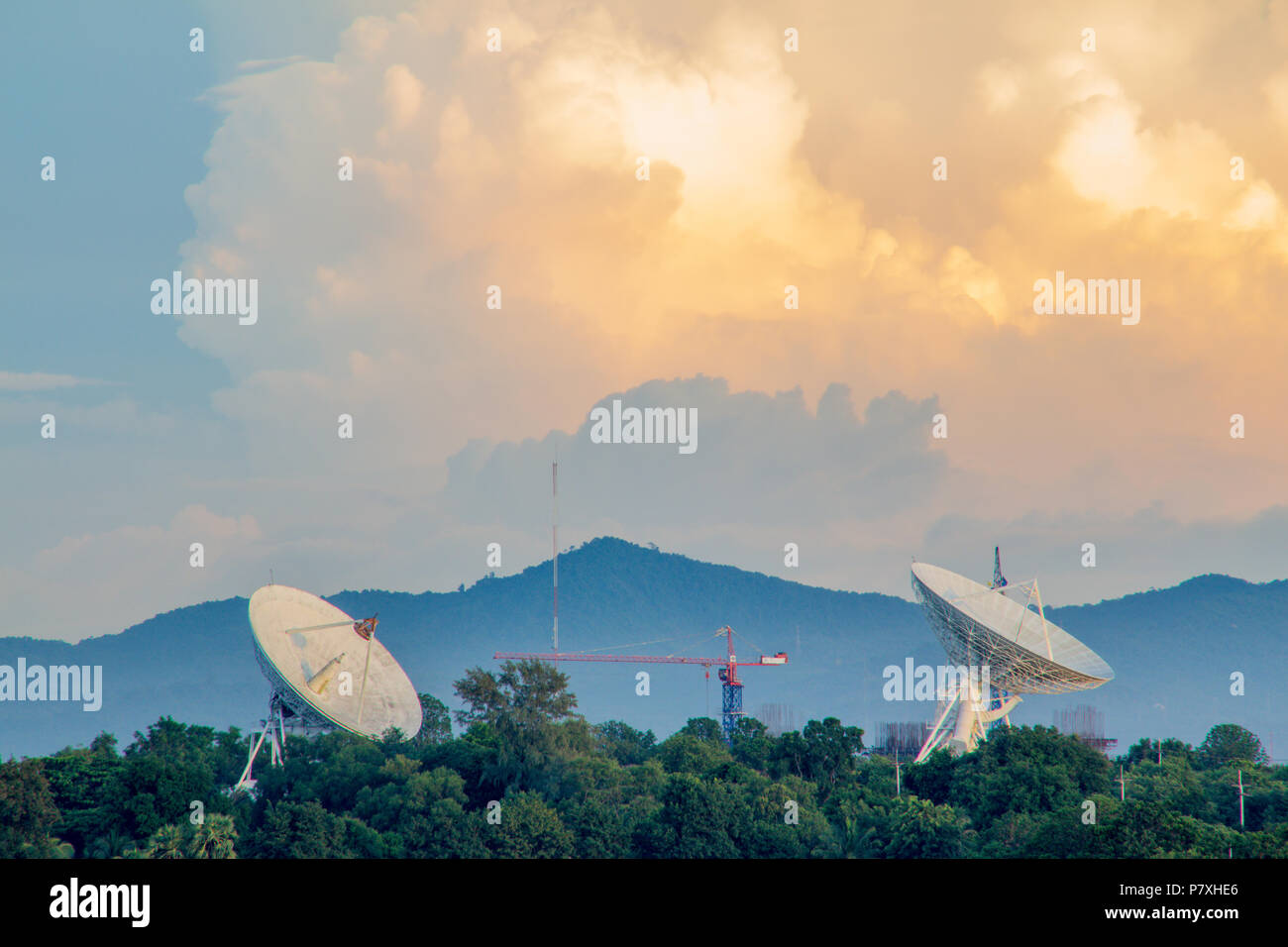 The gold sky with the gold cloud and two big satellite Stock Photo