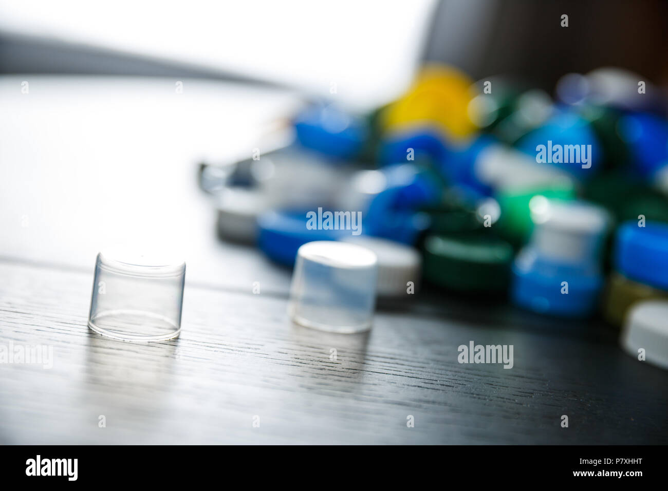 Collection of various colorful plastic screw caps - Stock Image