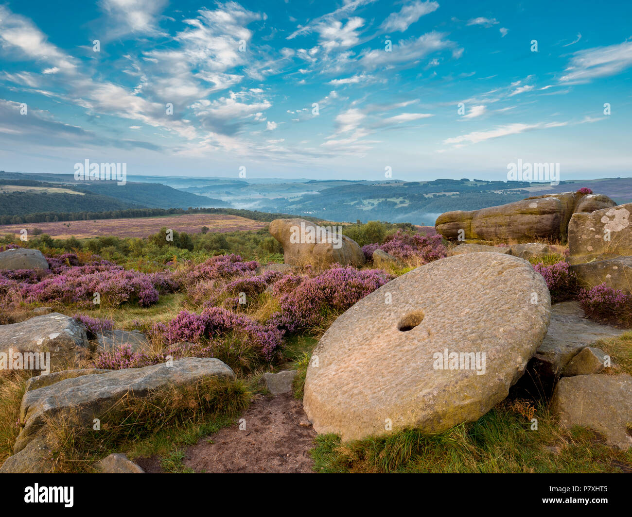 A large millstone on the moors above Hathersage. - Stock Image