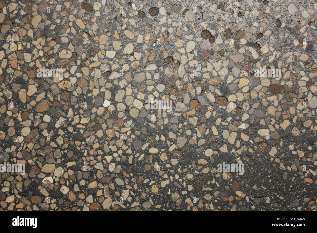 Extremely worn terrazzo flooring with many patchwork fixes and decades of wear at the CTA Blue Line Train Cumberland Station in Park Ridge, Illinois. - Stock Image