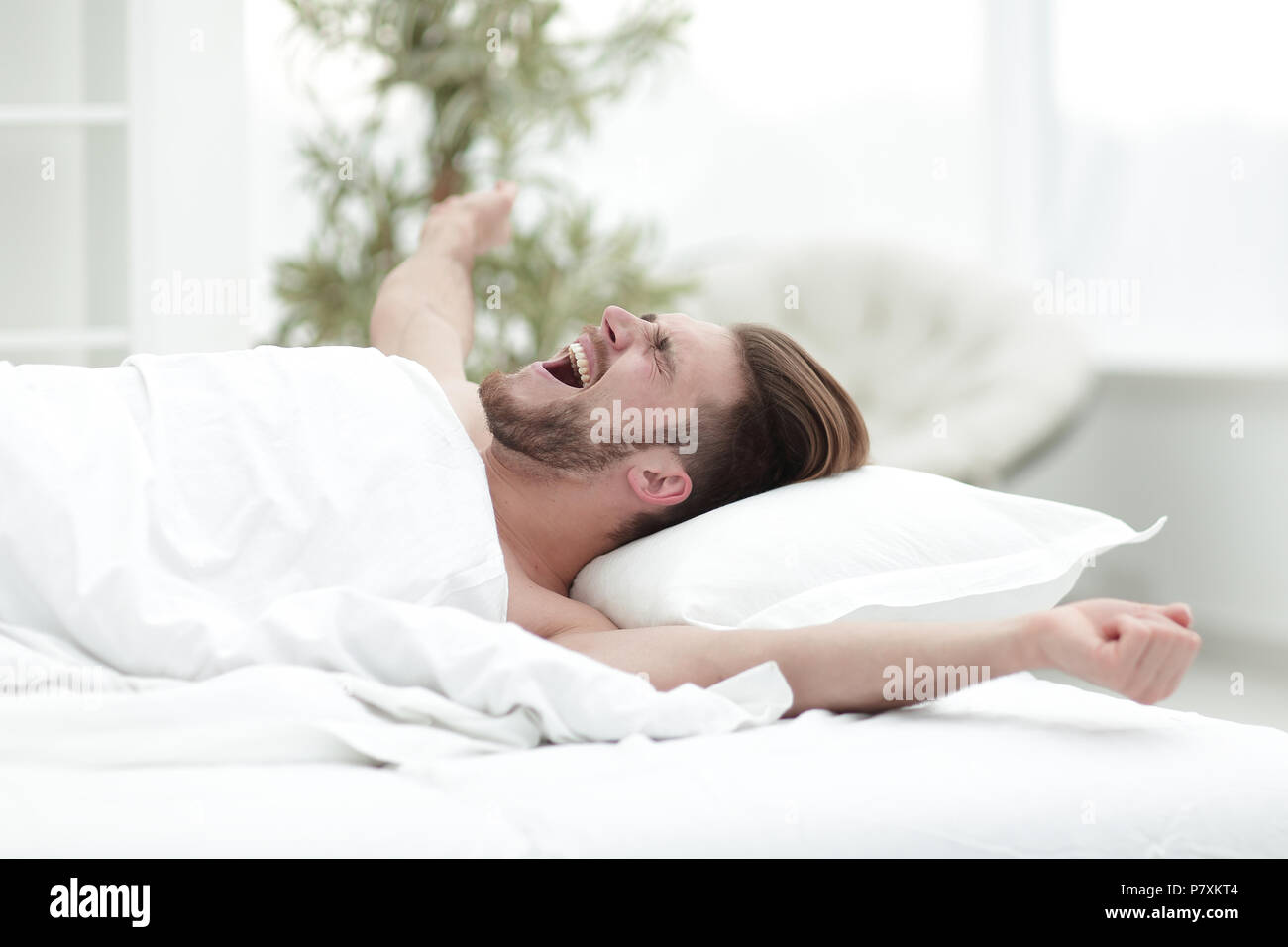 business man waking up on Sunday morning - Stock Image