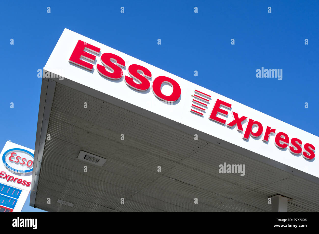 Esso Express lettering at gas station. Esso is ExxonMobil's primary gasoline brand worldwide. - Stock Image