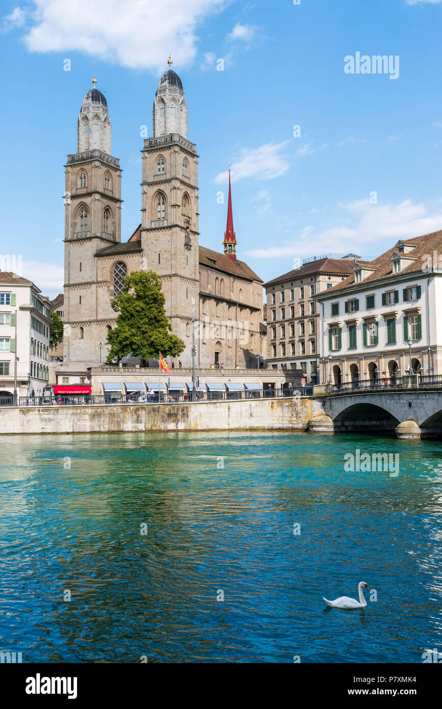 The Grossmünster cathedral in Zurich, Switzerland, as seen across the Limmat river - Stock Image