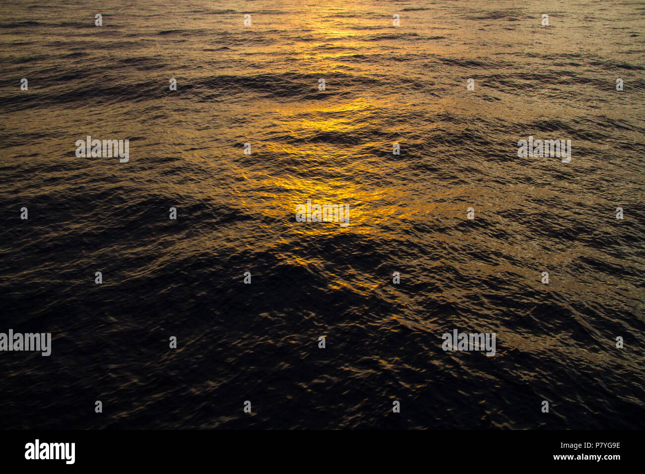 Advertising, Travel, Vacation and Holiday Concept - Sunsets lights reflections on the waves Stock Photo