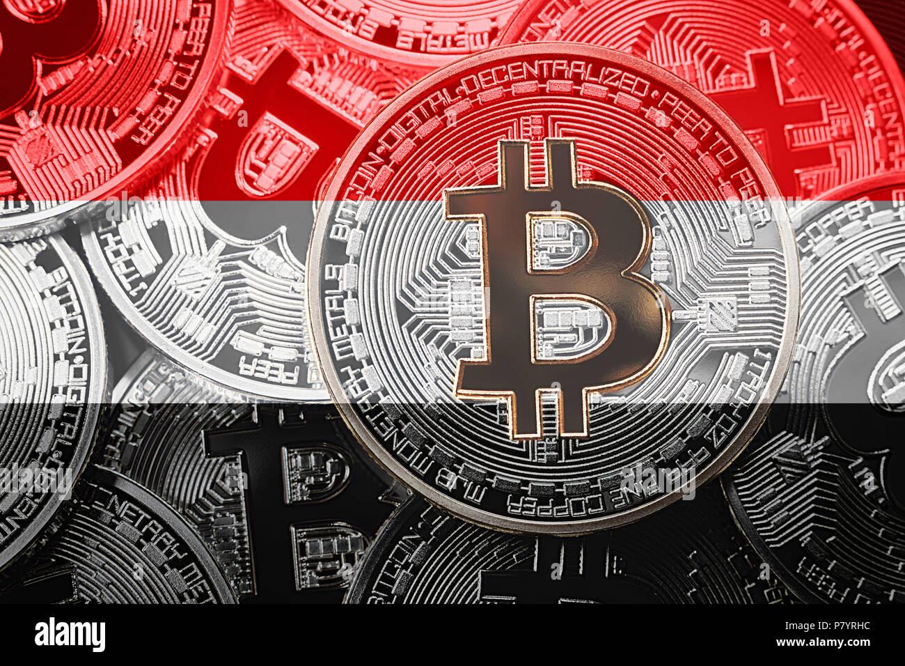 Stack of Bitcoin Yemen flag. Bitcoin cryptocurrencies concept. BTC background. Stock Photo