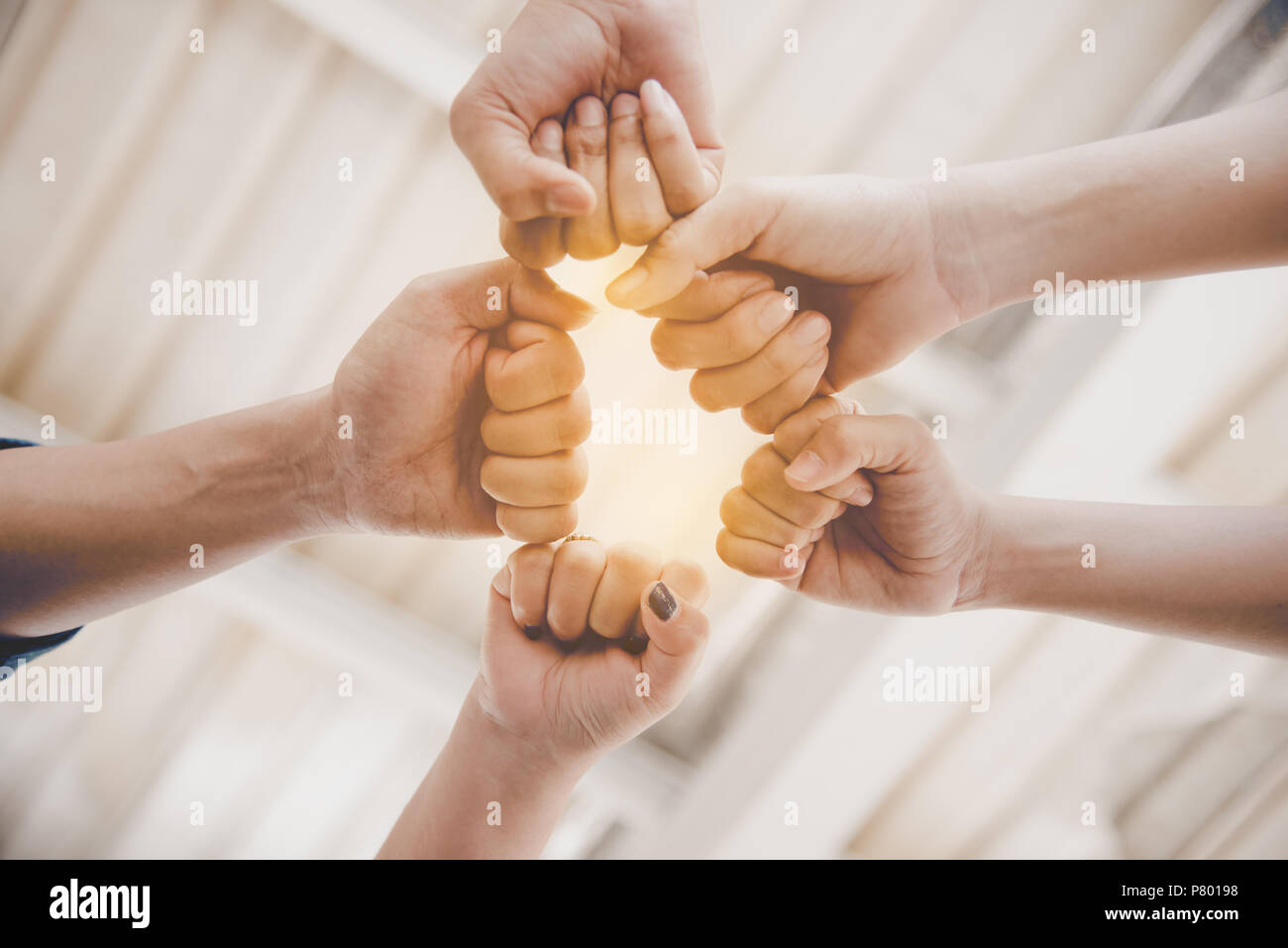 Fist Bump of friendship and teamwork for startup new project. Business and togetherness concept. Cooperation and Successful concept. People and hands  Stock Photo