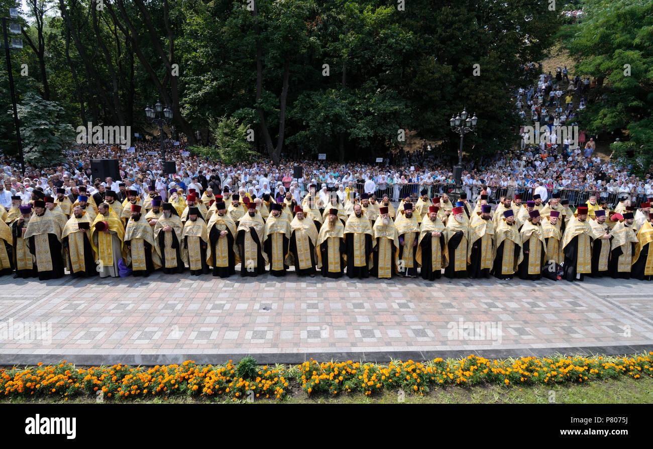 Crowd of parishioners and orthodox churchmen standing in the park Vladimirskaya gorka. Prayer, Day of Baptism of Rus. July 27, 2017. Kiev, Ukraine - Stock Image